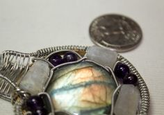 A very Firey Peice of Labradorite Surround by my signature SYberian Amethyst and Moonstones