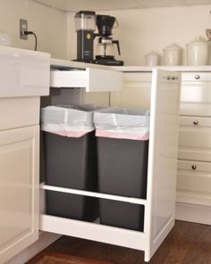 Two standard kitchen-sized trash cans fit in this tall drawer from Ikea. Trash bags and other supplies fit in the hidden pull-out drawer above.