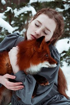 The Girl And The Fox Cuddle In Beautiful Photographs by Alexandra Bochkareva