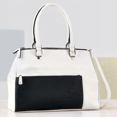 Block Multi Pocket Bag from Monroe and Main. Fun and functional colorblocking puts your great style sense to good use.