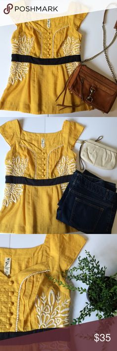 🎉SALE🎉  Anthropologie Floreat top Great top from Anthropologie brand Floreat.  He hire embroidery on the sides is slimming with a dark blue waist and yellow vintage buttons. Anthropologie Tops