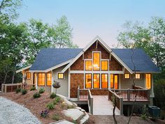 <ul><li>Corner windows, gabled glass, brackets and cedar shingle siding are just a few of the details that give this house plan its mountain charm and grace. With its quaint cottage detailing and bright open spaces is a charming mountain home perfect for a weekend getaway or an empty nesters retreat.</li><li>The angled entry provides just enough space to get out of the rain. Once inside you will enjoy the vaulted ceiling that extends through the living room to the porch.</li><li>The living…