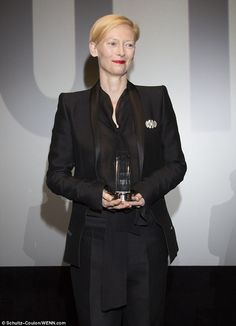 Androgynous beauty: Tilda Swinton suited up in all black to accept the Douglas Sirk Award in Hamburg, Germany Wednesday