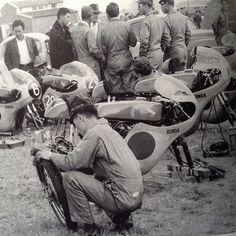 Honda mechanics working on the bikes at the Dutch GP , Assen in 1961.