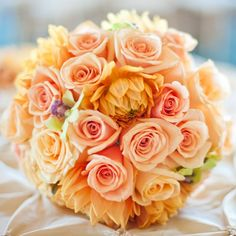 Peach roses mixed with orange peonies Beautiful for a fall wedding!