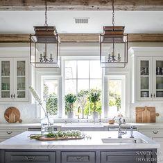 Farmhouse Kitchen-White Cabinets-Glass kitchen cabinets-rustic kitchen-wood beams-dark center island-white marble