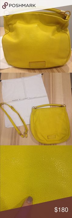 "Marc by Marc Jacobs ""Too Hot to Handle"" Hobo Purse Guaranteed authentic Marc Jacobs ""Too Hot to Handle"" cross-body hobo handbag.  I purchased this yellow handbag myself from Bloomingdales.  It is in great used condition.  There's a small scuff in the leather (more like 2 tiny dots).  The front of the bag is very slightly discolored where the strap was located when the bag was stored.  There are some black dots from a pen in one of the zipped pockets inside.  Overall, very clean and gorgeous…"