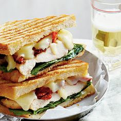 Smoky Chicken Panini with Basil Mayo Recipe | MyRecipes.com - Smoky Gouda cheese, sun-dried tomatoes, and baby spinach join grilled chicken breasts in this panini that's slathered with fresh Basil Mayo.