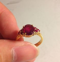 Authentic fine 2.3 carat red ruby ring with Burmese rubies on the side, 14K solid handmade gold ring.  via Etsy.