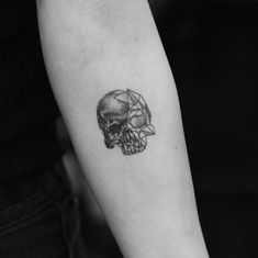 Small geometric skull tattoo by Evan Tattoo