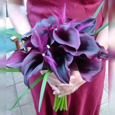 Dark purple calla and peacock bouquet
