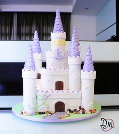 Sofia the First cake and dessert table - A castle cake I made for my godchild, Katherina.. please see the other picture of the very first dessert table I've prepared to match the princess theme :) I want to thank Jessica Harris for her very detailed and helpful blog about her castle cake.. without it, I can't pull this off.. please drop by to her blog if you want to learn how to make this, too :)