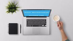 MacBook laptop on a white and clean desk next to a black notebooks, a pen, a plant and a coffee. Customize this image with your own app on PicApp.net - easy & free. #Macbook #coffee #green