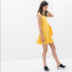 Zara yellow neoprene dress  Wrap style Zara dress with belt tie. New with tags. 94% polyester, 6% elastane. From the 2014 collection. Zara Dresses