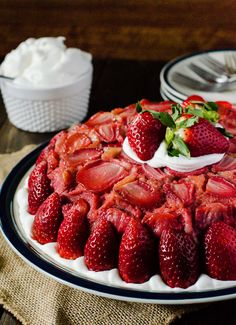 A shortcake twist on a classic upside down cake, stacked on top of creamy vanilla bean cheesecake, then studded with fresh Florida strawberries!