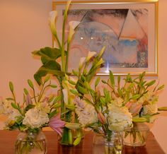 Ornamental cabbage and dusky pink asiatic lillies,with arum lillies for party decoration