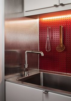In total, the renovation was completed for around $35,000. Photo 2 of 20 in Best Kitchen Metal Photos from Clever Red Pegboard Backsplash in a Remodeled Kitchen. Browse inspirational photos of modern kitchens.