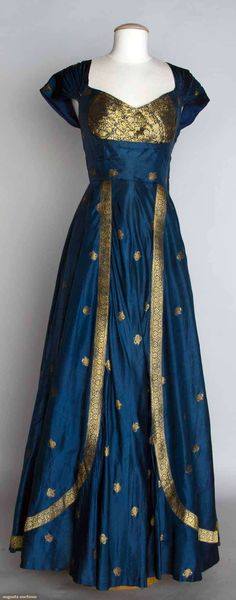 "BLUE & GOLD EVENING DRESS, 1950 Blue silk taffeta w/ metallic gold brocade, fashioned from Indian sari, B 33"", W 27.5"", L 60"", excellent."