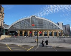 https://flic.kr/p/di86GC | Lime Street Gateway station, Liverpool | This magnificent Victorian facade was obscured from view for about 50 years because, incredibly, a row of low shops was built in front of it in the 1960s.  That decade has a lot to answer for in architectural terms!  Thank goodness the view has been restored to its former glory, so we can all see the station as the architect intended.