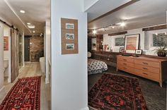 Master Bedroom Suite: Open Concept bath and bedroom, Barnwood Walls, Exposed Brick, Chilewich Flooring, White stone floors, Barn Doors, Kilim Rugs,, Painted White Brick Walls. 4502 N Magnolia Unit 1N Sheridan Park - Uptown - Chicago, Illinois - Christian Schaller Johnson Roberts Associates Architects Inc. 2015 For sale @ $485,000