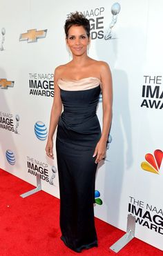 Halle Berry, who kept things relatively simple -- yet incredibly sexy -- in a strapless Vivienne Westwood column gown and dripping diamond earrings.