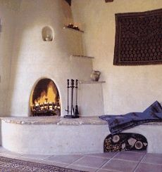 Fire places energetically support the south and southwest part of the home. Santa Fe style