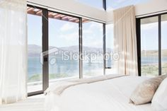Modern bedroom with view of lake Royalty Free Stock Photo