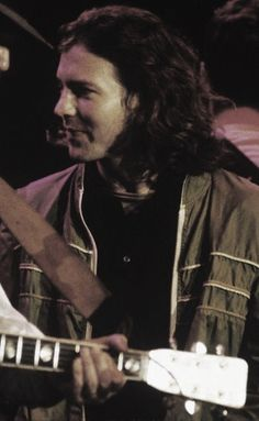 Eddie Vedder. I so love this shorter hair, and what a cute look on his face.