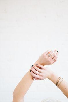 Black nails + dainty jewelry