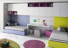 #Dormitorio juvenil con #cama con cajones y cama arcón con somier apertura lateral. Mesa estudio central y altillos en la parte superior.