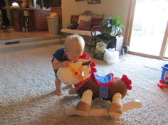 My cute nephew kissing his cowboy rocking horse from RockABye! Click for his review...
