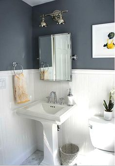 Pedestal sink and wainscoting