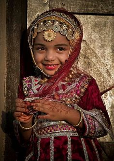 "thesecretsinaveil: "" A Baby Girl Wore an Omani Traditional Dress. She Looks So Cute! """