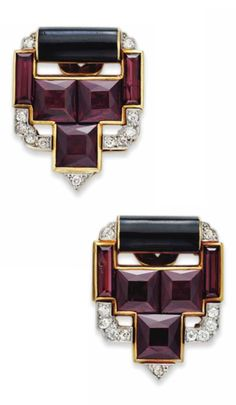 A PAIR OF ART DECO GARNET, DIAMOND AND ENAMEL CLIP BROOCHES, BY CARTIER, CIRCA 1925. Each designed as a rectangular and square-cut garnet openwork clip of geometric motif, trimmed with old mine-cut diamonds and a black enamel plaque, mounted in gold, signed Cartier.