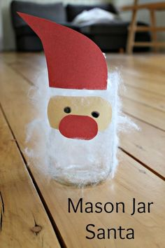 Unbelievably cute!!! Fuzzy Santa Christmas mason jar crafts for kids! Great sensory activity too - I just love using contact paper with preschoolers.