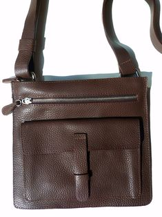 Busy? Travel? Enjoy life? Soccer mom? If you have better things to do with your arms and want a perfect bag to carry and organize your essentials, you are in heaven. Sometimes you need to leave the house and have better use for your arms. It's perfect for a fun evening out, or for running errands - who says convenience can't be stylish? Certainly not IMPERIO jp... 2 zippered compartments plus an exterior pocket with flap. Fully lined, and our signature pebble grain leather only gets better…