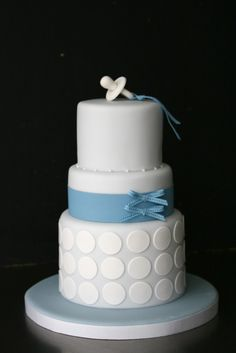 Baby shower cake with pacifier topper.... sugarplum