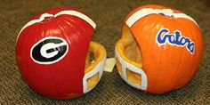 Pumpkins carved as football helmets.