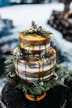 Winter Forest Floral Wedding Cake. 3 Tiered, Naked caramel drizzled cake. Erin Wheat Co.