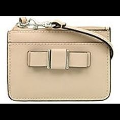 """SALE!! NWT Coach skinny mini ID/wristlet/wallet SALE!!! NWT Coach skinny mini ID/wristlet/wallet.  This also can be worn on your keychain!!  Coach box included!!  Measures approx 5"""" in length & 4"""" in height Coach Bags Wallets"""