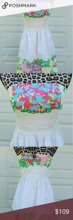 Lilly Pulitzer Mariposa white floral dress sz 4 Lilly Pulitzer Resort white Mariposa summer strapless dress. Size four. Excellent condition. No flaws seen. In the photo, it may appear that the back does not zip all the way. It does zip all the way up, my mannequin is just too big. ;)  $188 retail. Lilly Pulitzer Dresses Strapless