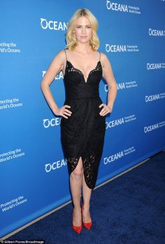On show: January Jones showcased her assets in a plunging black gown when she attended A C...