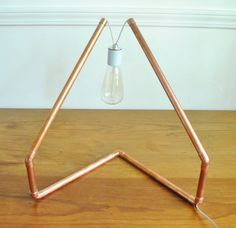 Copper tube lamp with vintage bulb