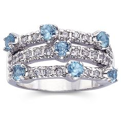 This powerful ring packs quite a punch of fashion panache. Featuring a triple-row design, it has 7 brilliant-cut genuine blue topaz stones surrounded by 28 round white cubic zirconia. Product Specific