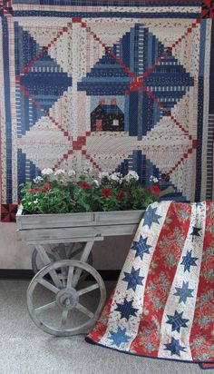 Cabin on the Shore and Quilt of Valor, designs by Minick & Simpson as seen at the Holly Hill Quilt Shoppe