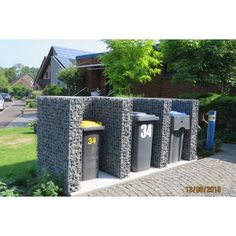 Build gabions to hide your trash cans.