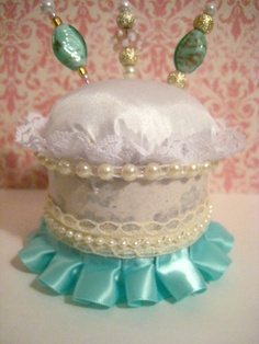 shabby chic/victorian pin cushion with stick pins.
