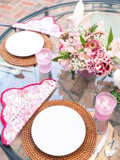 """Elevate any table with my scalloped napkin and placemat set. The pink floral pattern is a custom block print, and elegantly accented by scarlet scalloping. This set makes a wonderful gift for any occasion. PRODUCT DETAILS Set includes: 4 napkinsand 4 circle placemats Circle placemats are 16"""" diameter Square napkins are 22"""" across Hand block printed 100% cotton Machine washable Handmade in Jaipur, India Hand Printed Fabric, Printing On Fabric, Outdoor Table Settings, Table Setting Inspiration, Linen Placemats, Custom Screen Printing, Pink Table, Perfect Pink, Napkins Set"""