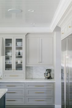 Light cabinets not white but rustic antique white washed