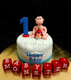 Baby Monster's 1st Birthday Cake  *not a fan of the actual cake, just of the baby blocks but I would put her name on them